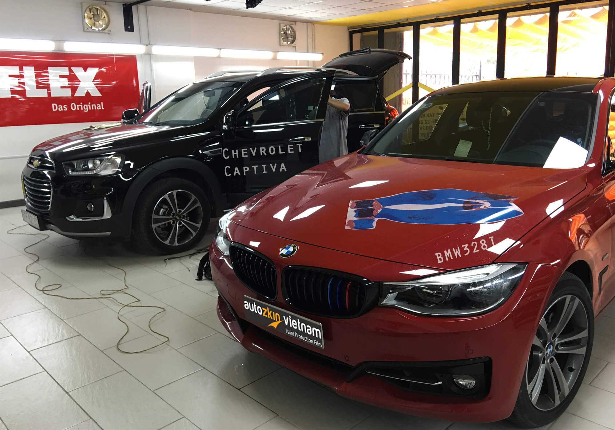 BMW 328i & Chevrolet Captiva